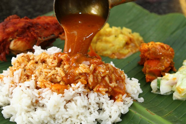 Each-banana-leaf-rice-serving-at-Sri-Paandi-comes-with-pappadam-cucumber-brinjal-and-other-vegetables.-630x420[1]