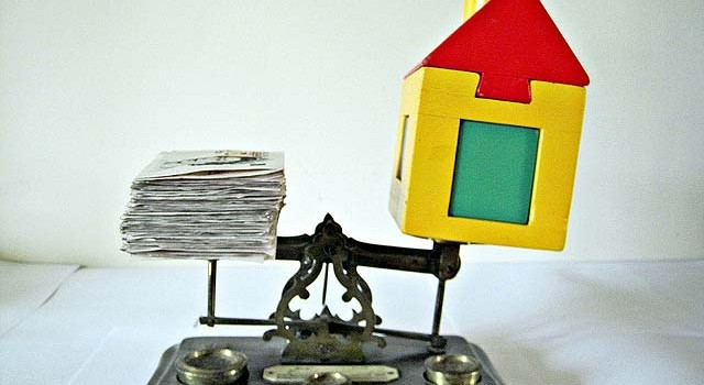 money-and-toy-house-on-scale-640x350[1]